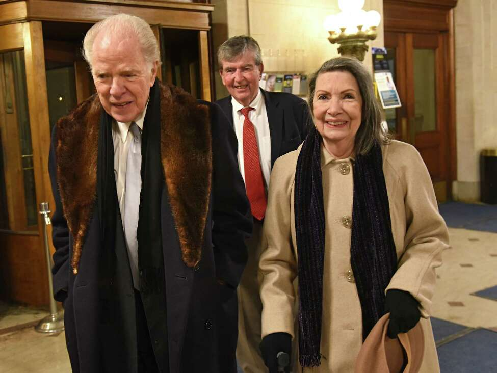 William Kennedy and his wife Dana arrive at an event where the City of Albany celebrated his 90th Birthday at Albany City Hall on Wednesday, Jan. 31, 2018 in Albany, N.Y. The event also marks the 35th Anniversary of the New York State Writers Institute which was founded by Kennedy in 1983. Senator Neil Breslin follows behind the couple who were also celebrating their 61st wedding anniversary. (Lori Van Buren/Times Union)