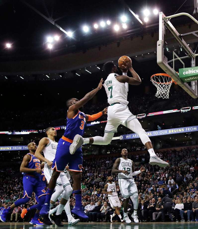 Boston Celtics guard Jaylen Brown (7) drives to the basket past New York Knicks forward Tim Hardaway Jr. (3) during the second quarter of an NBA basketball game in Boston, Wednesday, Jan. 31, 2018. (AP Photo/Charles Krupa) Photo: Charles Krupa / Copyright 2018 The Associated Press. All rights reserved.
