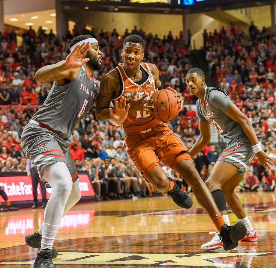 LUBBOCK, TX - JANUARY 31: Kerwin Roach II #12 of the Texas Longhorns drives to the basket against Tommy Hamilton IV #0 of the Texas Tech Red Raiders during the first half of the game on January 31, 2018 at United Supermarket Arena in Lubbock, Texas. (Photo by John Weast/Getty Images) Photo: John Weast/Getty Images