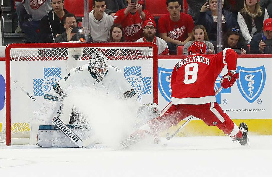 The Red Wings' Justin Abdelkader scores the decisive goal against Sharks goaltender Martin Jones during the seventh round of the shootout. Photo: Paul Sancya, Associated Press