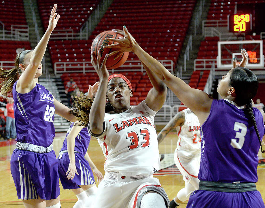 Lamar's Kiandra Bowers snags the rebound against Abilene Christian's Dominique Golightly during their game at the Montagne Center Wednesday. The Lady Cardinals are aiming to continue their record-setting winning streak. Photo taken Wednesday, January 31, 2018 Kim Brent/The Enterprise Photo: Kim Brent, Beaumont Enterprise / BEN