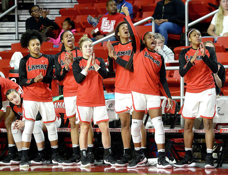 Lamar's bench cheer as they score against Abilene Christian during their game at the Montagne Center Wednesday. The Lady Cardinals are aiming to continue their record-setting winning streak. Photo taken Wednesday, January 31, 2018 Kim Brent/The Enterprise Photo: Kim Brent, Beaumont Enterprise / BEN
