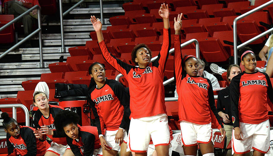 Lamar's bench react as they take in the action against Abilene Christian during their game at the Montagne Center Wednesday. The Lady Cardinals are aiming to continue their record-setting winning streak. Photo taken Wednesday, January 31, 2018 Kim Brent/The Enterprise Photo: Kim Brent, Beaumont Enterprise / BEN