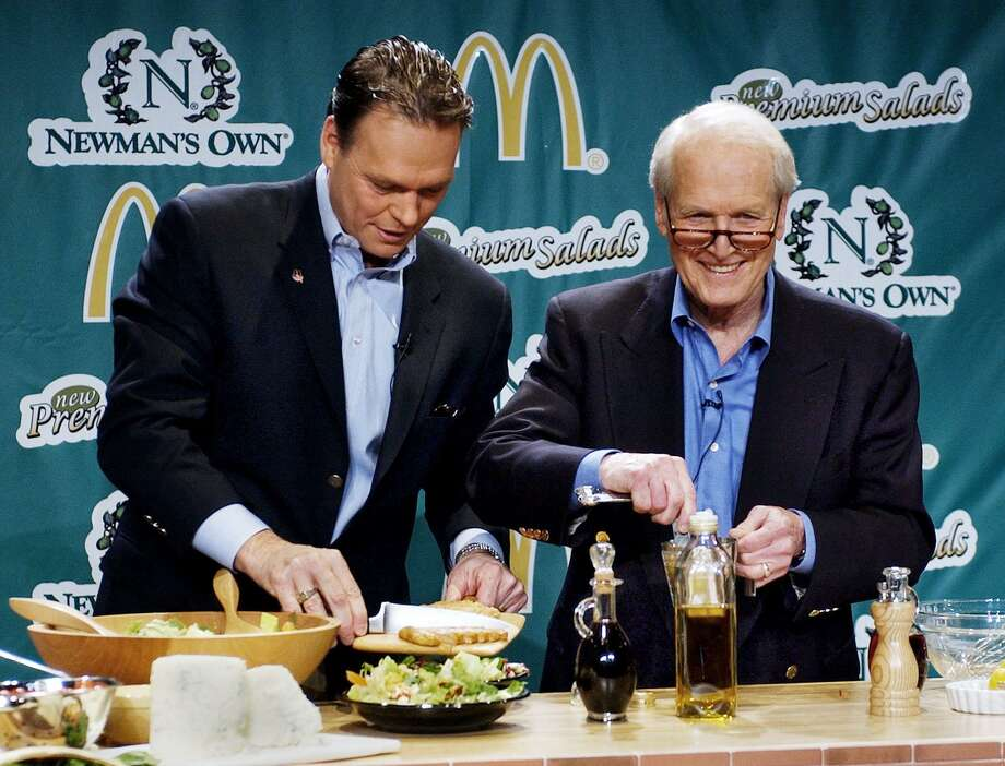 The late Paul Newman, right, in March 2003 in New York City to promote his Newman's Own salad dressings being made available at McDonald's. On Feb. 1, 2018, the Westport, Conn.-based Newman's Own Foundation announced it had reached the milestone of giving away $500 million to charitable causes since 1982 when Newman launched the foundation. (AP Photo/Stan Honda, HO) Photo: STAN HONDA / AP / MCDONALDS