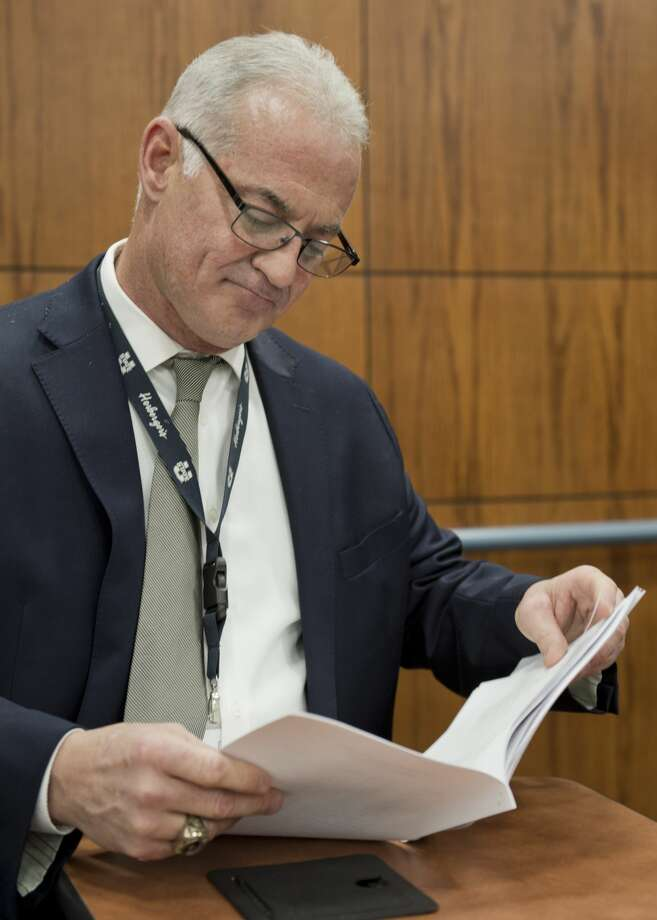 MISD Athletic Director Randy Rowe looks through the new UIL classification sheets handed out 02/01/18 morning at the Midland College ATC. Tim Fischer/Reporter-Telegram Photo: Tim Fischer/Midland Reporter-Telegram