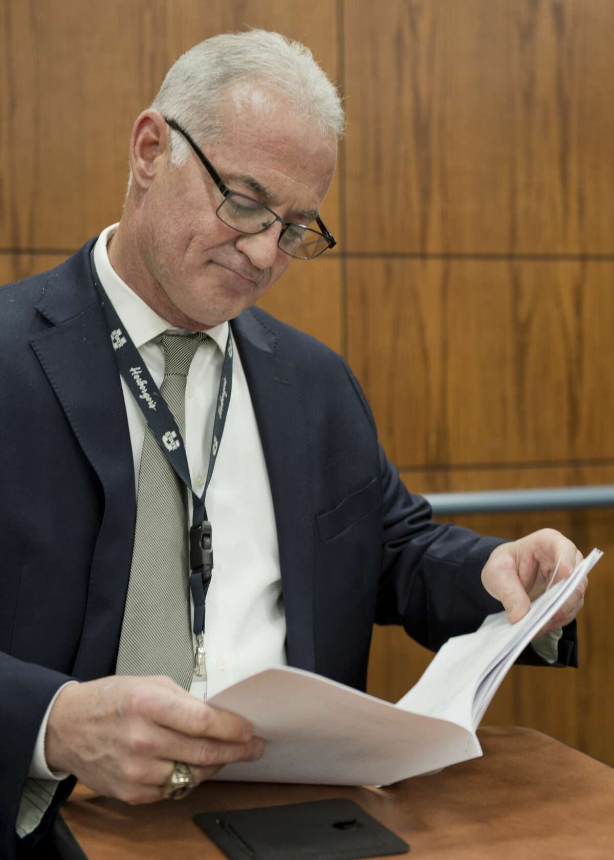 MISD Athletic Director Randy Rowe looks through the new UIL classification sheets handed out 02/01/18 morning at the Midland College ATC. Tim Fischer/Reporter-Telegram