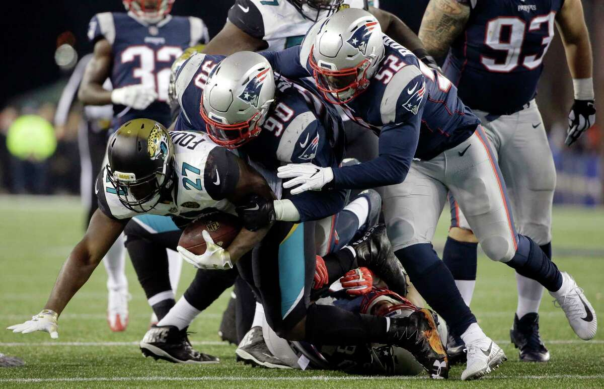 FILE- In this Sunday, Jan. 21, 2018, file photo, Jacksonville Jaguars running back Leonard Fournette (27) is tacked by New England Patriots defensive tackle Malcom Brown (90) and linebacker Elandon Roberts (52) during the second half of the AFC championship NFL football game in Foxborough, Mass. The Patriots and the Philadelphia Eagles are set to meet in Super Bowl 52 on Sunday, Feb. 4, 2018, in Minneapolis. (AP Photo/Steven Senne, File) Roberts, a former player for the Cougars, will look to add Super Bowl rings with the Patriots on Sunday.