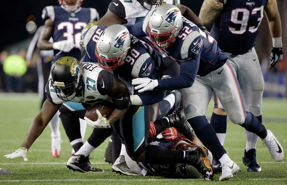 FILE- In this Sunday, Jan. 21, 2018, file photo, Jacksonville Jaguars running back Leonard Fournette (27) is tacked by New England Patriots defensive tackle Malcom Brown (90) and linebacker Elandon Roberts (52) during the second half of the AFC championship NFL football game in Foxborough, Mass. The Patriots and the Philadelphia Eagles are set to meet in Super Bowl 52 on Sunday, Feb. 4, 2018, in Minneapolis. (AP Photo/Steven Senne, File)Roberts, a former player for the Cougars, will look to add Super Bowl rings with the Patriots on Sunday. Photo: Steven Senne, Associated Press / Copyright 2018 The Associated Press. All rights reserved.