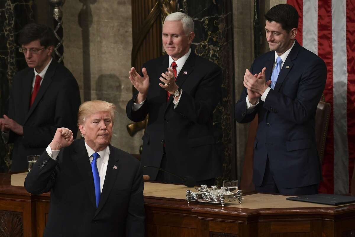 President Donald Trump gestures at the end of his State of the Union address to a joint session of Congress on Capitol Hill in Washington, Tuesday, Jan. 30, 2018. (AP Photo/Susan Walsh)