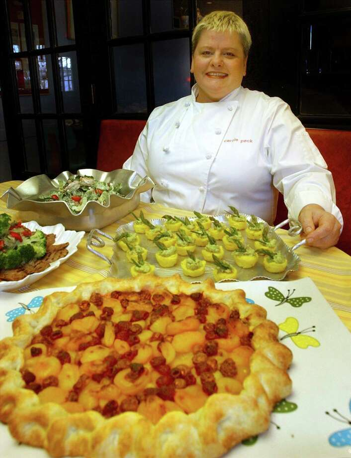 Chef Carole Peck has hopscotched around the country, but feels settled at her Good News Cafe in Woodbury, celebrating its 25th anniversary. Photo: Hearst Connecticut Media / File Photo / The News-Times File Photo