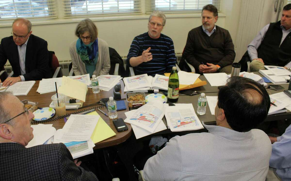 Members of the Saugatuck Transit Oriented Design Master Plan Committee (back row, from left to right): Sam Levenson, Eileen Berenyi, Matthew Mandell, Ian Warburg, and Ward French) discuss the Saugatuck Transit Oriented Design Master Plan at a meeting in Town Hall on Jan. 30.
