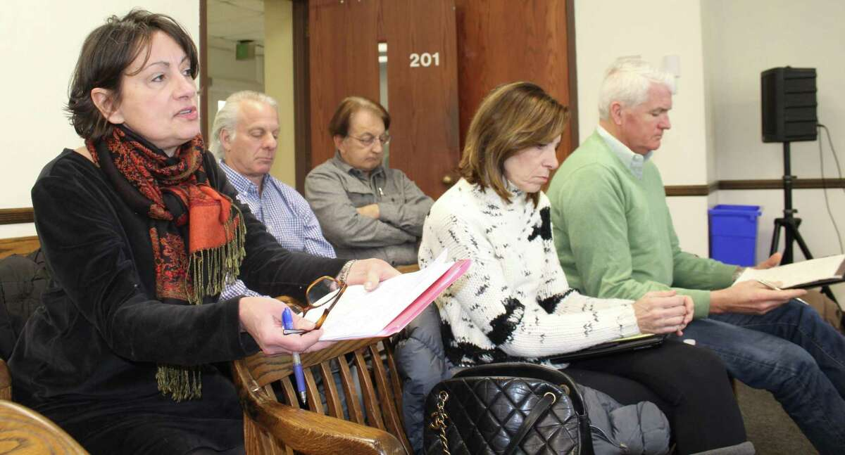 Save Westport Now co-chairwoman Valerie Seiling Jacobs, left, voices her opposition to the Saugatuck-Transit Oriented Design Master Plan at a meeting to discuss the report on Tuesday in Westport Town Hall.