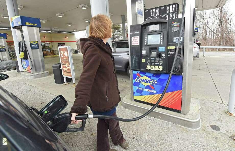 Cathy Lott of Bethlehem pumps gas at a Sunoco gas station on Thursday, Feb. 1, 2018 in Albany, N.Y. (Lori Van Buren/Times Union) Photo: Lori Van Buren, Albany Times Union / 20042811A