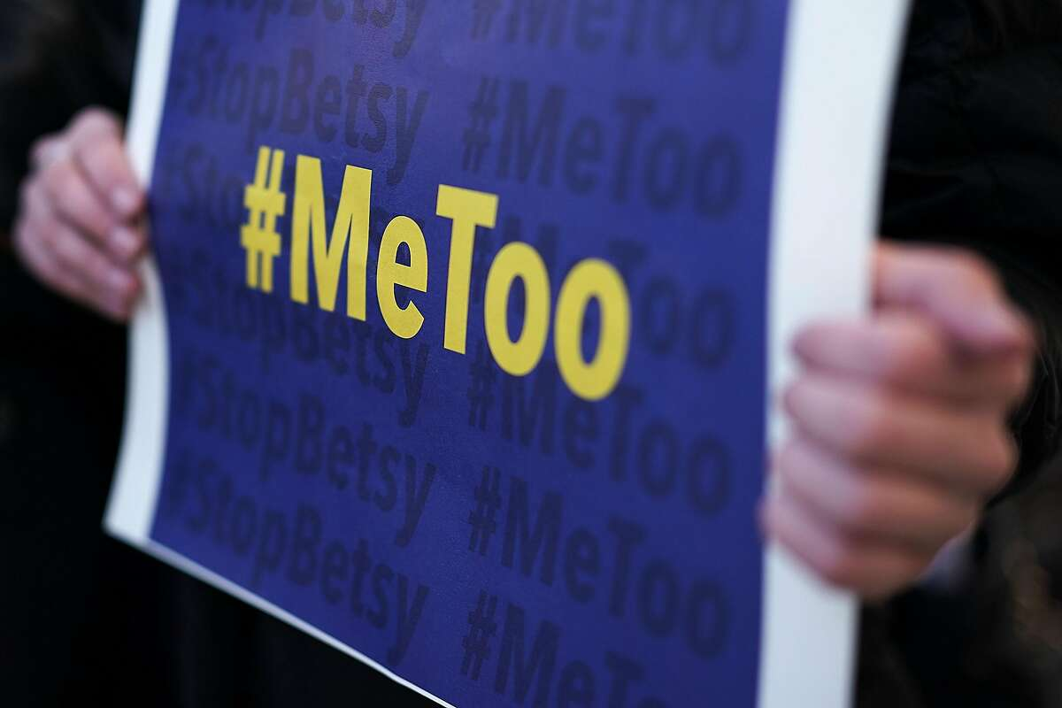WASHINGTON, DC - JANUARY 25: An activist holds a #MeToo sign during a news conference on a Title IX lawsuit outside the Department of Education January 25, 2018 in Washington, DC. Anti-sexual harassment groups held a news conference to announce a