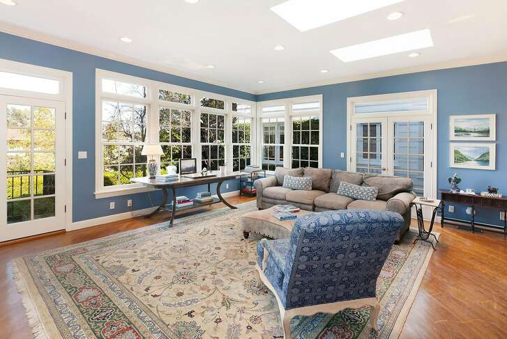 The family room looks out at the garden through divided light windows.