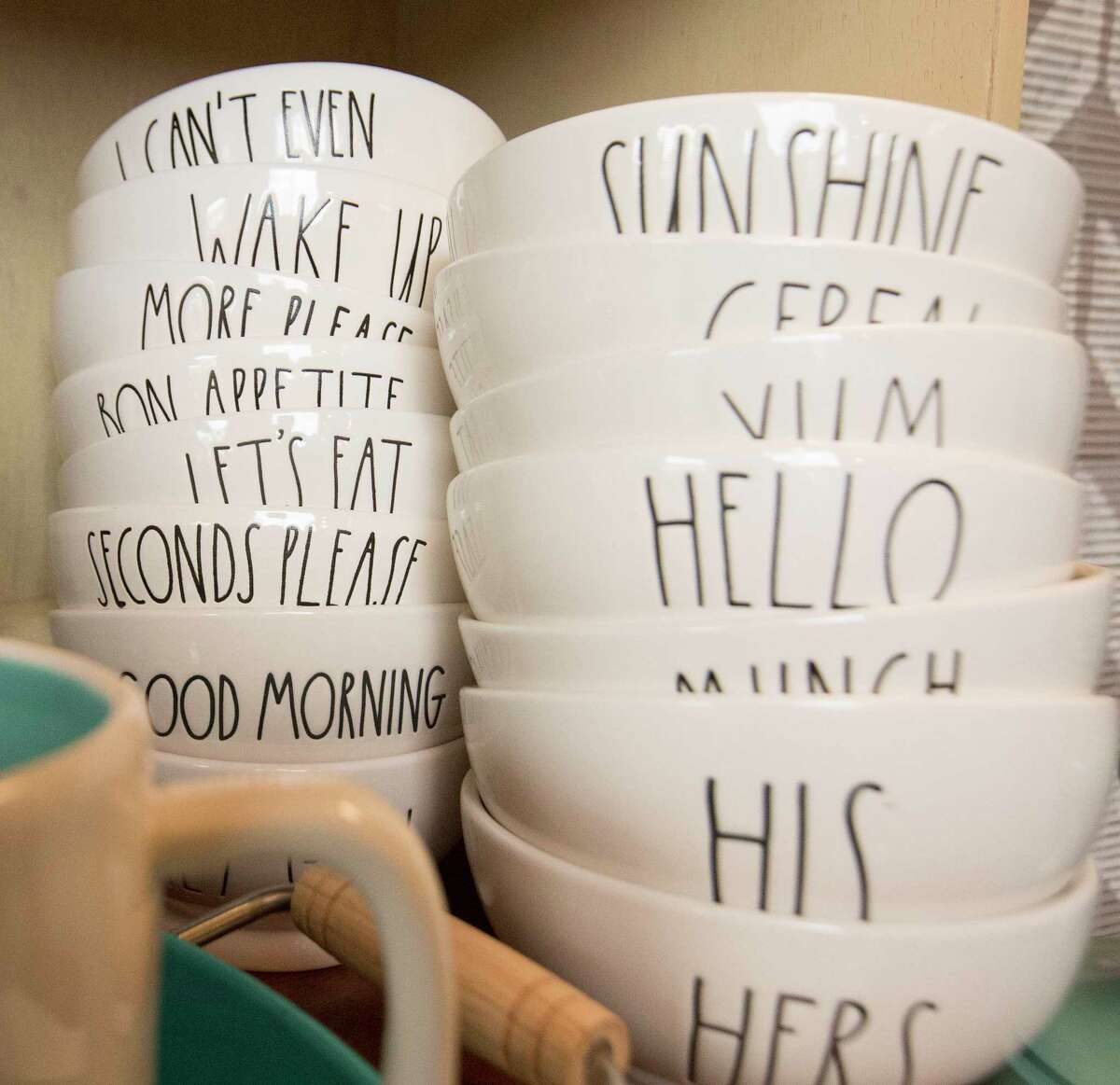 """Shannon Wilson's first Rae Dunn find was a bowl that said """"Sunshine"""" in long letters. Now she has dozens of bowls in her collection, which includes more than 300 pieces total. ( Yi-Chin Lee / Houston Chronicle )"""