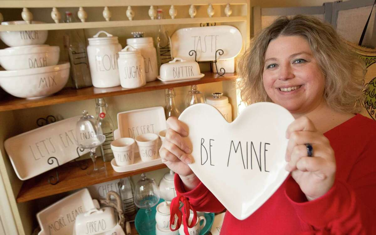 Shannon Wilson holds a Rae Dunn Valentine's Day collection plate and poses for a portrait with her favorite Rae Dunn collections at home on Thursday, Jan. 25, 2018, in Tomball. Wilson likes to collect the long letters ceramic products. ( Yi-Chin Lee / Houston Chronicle )