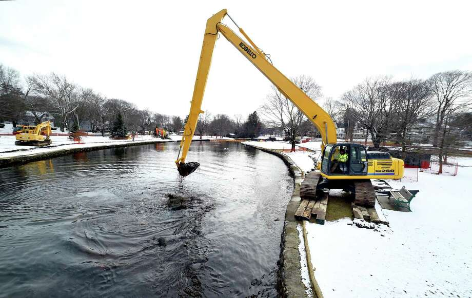 Dredging work of the North Street Duck Pond in Milford  takes place on January 30, 2018. Photo: Arnold Gold / Hearst Connecticut Media / New Haven Register