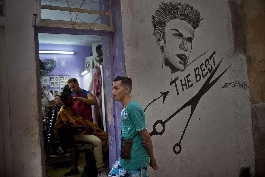 A client waits his turn to get his hair cut at a private barber shop in Havana. Self-employed Cubans now comprise 12 percent of the island's workforce. Photo: Ramon Espinosa, Associated Press