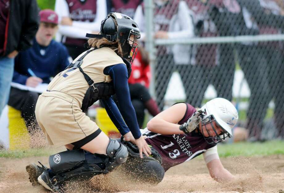 Cohoes catcher Courtney Gumprecht puts the tag on a sliding Lansingburgh runner Meg Volz at home plate. (Luanne M. Ferris / Times Union) Photo: LUANNE M. FERRIS