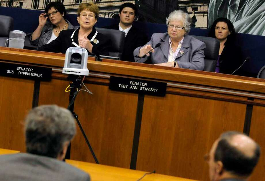 State Senators Suzi Oppenheimer, left, and Toby Ann Stavisky listen as State Education  Commissioner David M. Steiner speaks Wednesday in support of Regents-approved changes during a hearing on teacher preparedness in the 21st century at the Capitol. (Michael P. Farrell/Times Union) Photo: MICHAEL P. FARRELL
