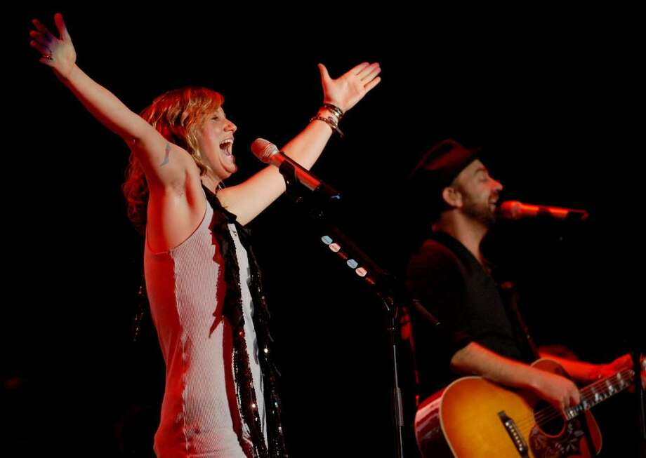 Members of Sugarland, Jennifer Nettles, left, and Kristian Bush perform at the Times Union Center on Wednesday, Oct. 7, 2009, in Albany, NY.   (Luanne M. Ferris / Times Union) Photo: LMF / 00005819A