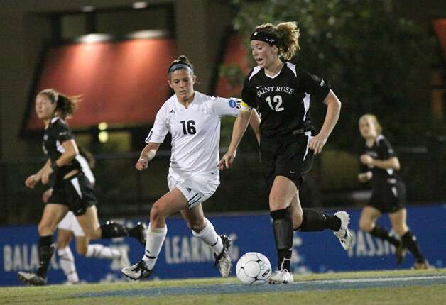 Amanda Deck of the College of Saint Rose, center, fights for a ball against Grand Valley State. (Scott Purks/Special to the Times Union)