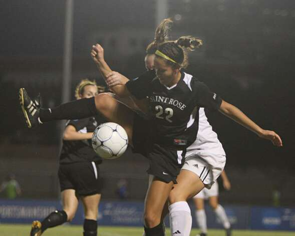 Gianna D'Errico (22) of the College of Saint Rose fights for a ball. (Scott Purks/Special to the Times Union)