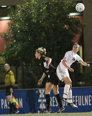 Players fight for a header in Thursday's Division II National Women's semfinal in which Saint Rose lost 3-2 to Grand Valley State, ending the Golden Knights' season at 24-1. (Scott Purks/Special to the Times Union)