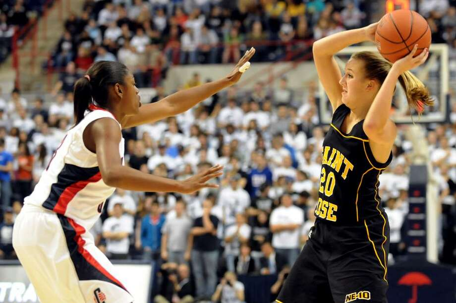 St. Rose's Ashley Rath (20), right, looks to pass as UConn's Tiffany Hayes (3) defends during their exhibition basketball game on Thursday, Nov. 5, 2009, at University of Connecticut in Storrs, Conn. (Cindy Schultz / Times Union) Photo: CINDY SCHULTZ