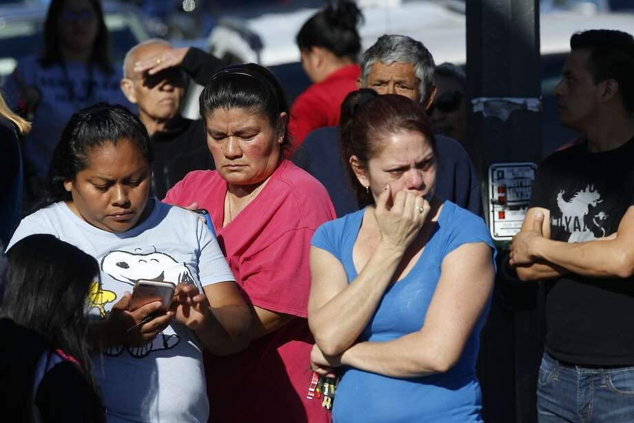 Parents wait for news at a Los Angeles middle school. Police arrested a female student suspect. Photo: Damian Dovarganes, Associated Press