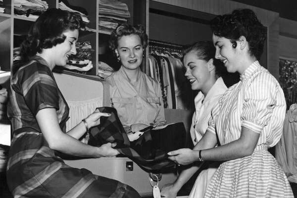 1950: Isabell Gerhart, second from left, checks merchandise in her River Oaks store with saleswomen, L-R, Cynthia Wayman Russ, Betty Stavinoha and Elsie Shirocky Ceepo.
