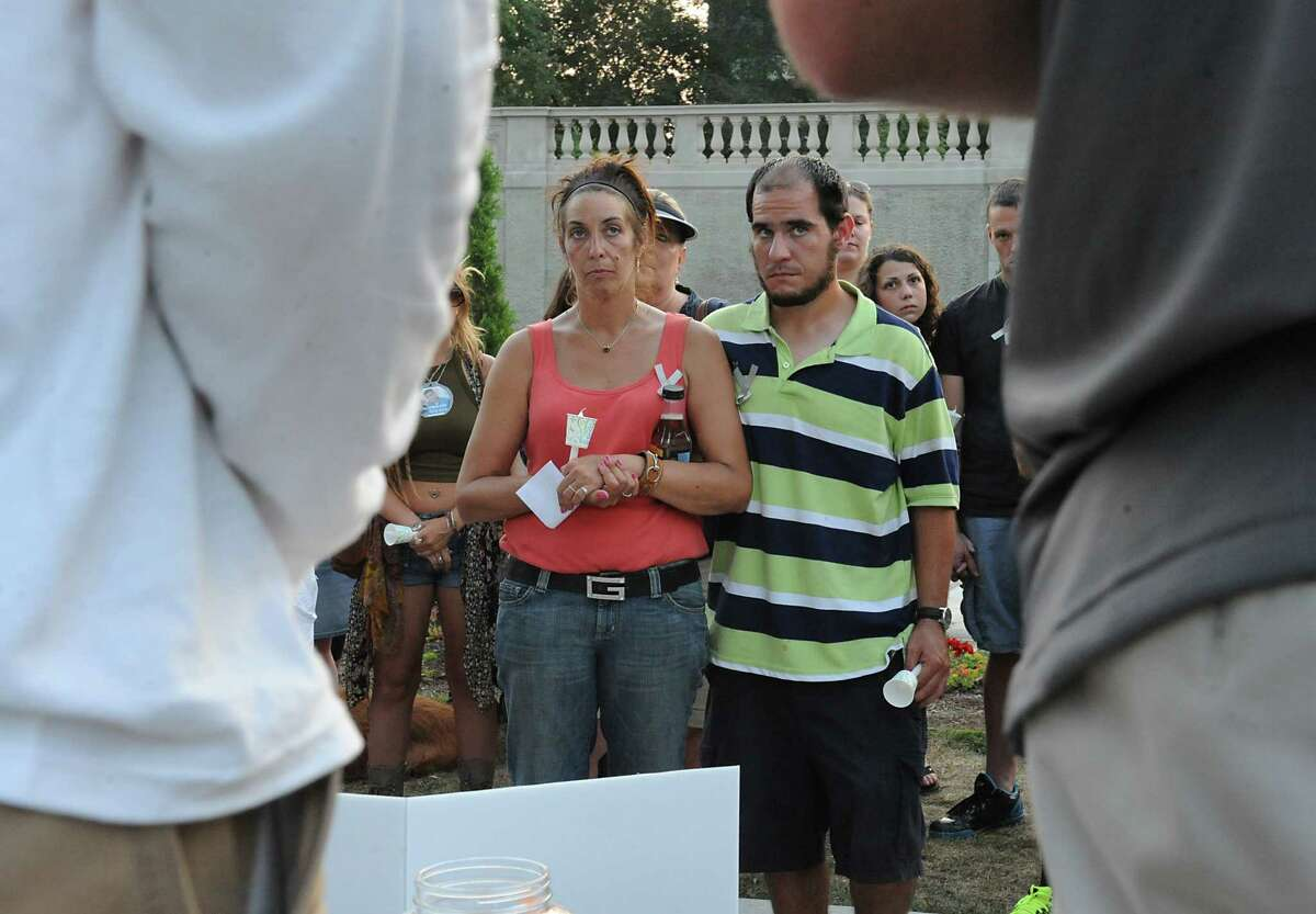 Katie-Lynn Scheidt's mother recognized a suspect in her daughter's overdose death when she attended a vigil in Congress Park in 2015. That man, Matthew Charo, was also photographed at the vigil by the Times Union, seen here in the striped shirt. He was convicted in 2017 in connection with Katie-Lynn's overdose.