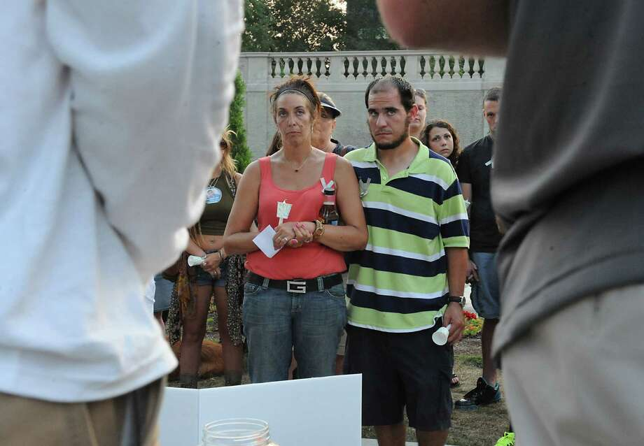Katie-Lynn Scheidt's mother recognized a suspect in her daughter's overdose death when she attended a vigil in Congress Park in 2015. That man, Matthew Charo, was also photographed at the vigil by the Times Union, seen here in the striped shirt. He was convicted in 2017 in connection with Katie-Lynn's overdose.  Photo: Lori Van Buren / 00033117A