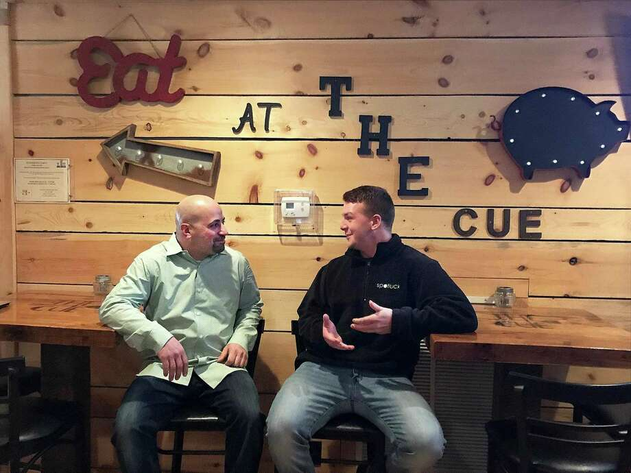 The Cue owner Joe Yorio, left, talks with Nick Jimenez of Spotluck on Thursday, Feb. 1, 2018, ahead of the Spotluck launch party at the restaurant in Danbury, Conn. Spotluck is a an app that allows users to receive discounts at local restaurants. Photo: Chris Bosak / Hearst Connecticut Media / The News-Times