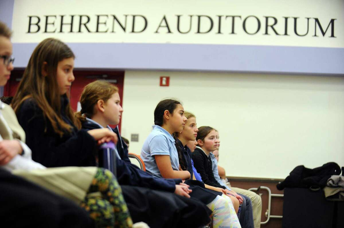 Bi Cultural Day School students listen to a presentation given by non-profit group myFace about kids with facial differences, and how to prioritize kindness over bullying, inside the Behrend Auditorium in Stamford, Conn. on Wednesday, Jan. 31, 2018. MyFace is a non-profit organization dedicated to transforming the lives of patients with craniofacial conditions while also educating the public about these facial differences like Treacher Collins syndrome, which was recently highlighted in the movie