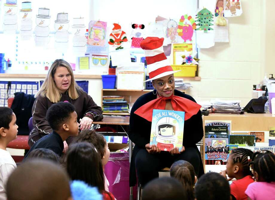 "Karen Lorde, right, school climate and culture teacher leader, discusses ""We're All Wonders"" by R. J. Palacio with students at Roberto Clemente School in New Haven for World Read Aloud Day on February 1, 2018. Photo: Arnold Gold / Hearst Connecticut Media / New Haven Register"