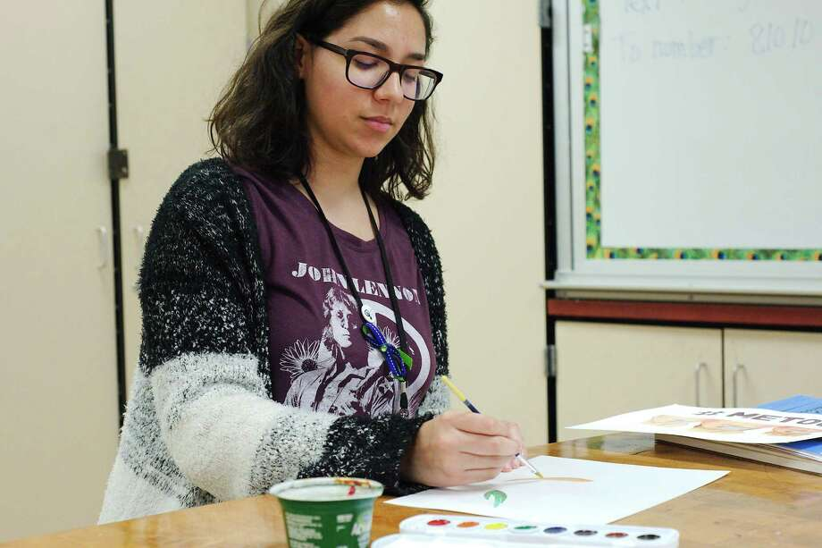 Dobie High School student Graciella Delgado works on a painting in her favorite work space at the school. Her watercolor  supporting the #MeToo movement was selected by The New York Times to be included in a newsletter. Photo: Kirk Sides / © 2018 Kirk Sides / Houston Chronicle
