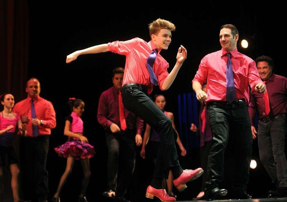 Tap dancer Phoenix Goodman entertains with his father Brian in the parent/child performance number to open Flash Pointe Dance's 2018 Fire & Ice Benefit at the Klein Memorial Auditorium in Bridgeport, Conn. on Sunday, January 28, 2018. Proceeds benefited Fairfield charity Al's Angels and the American Red Cross. Photo: Brian A. Pounds / Hearst Connecticut Media / Connecticut Post