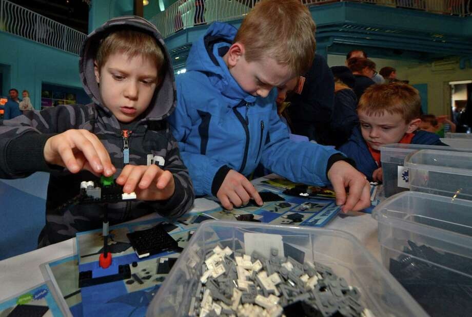 Luke Leondires, 6, of Westport, left, builds a LEGO stingray for an enormous aquarium-themed scene built by Play-Well TEKnologies as The Maritime Aquarium celebrates LEGO with a LEGO Weekend in Newman's Own Hall Saturday January 27 2018 in Norwalk, Conn. Kids built sea creatures out of LEGO to add to the sea scene during the activity that will continue Sunday. Photo: Erik Trautmann / Hearst Connecticut Media / Norwalk Hour