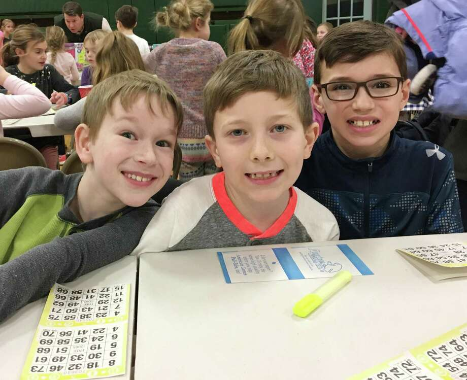Holmes School fourth-graders Jack Lubeley, Tommy Galligan and Jack Bryer play bingo in the school's gymnasium on Jan. 19. Bingo Night was a fundraiser for the Parent-Teacher Organization. Photo: Contributed Photo