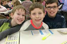 Holmes School fourth-graders Jack Lubeley, Tommy Galligan and Jack Bryer play bingo in the school's gymnasium on Jan. 19. Bingo Night was a fundraiser for the Parent-Teacher Organization.
