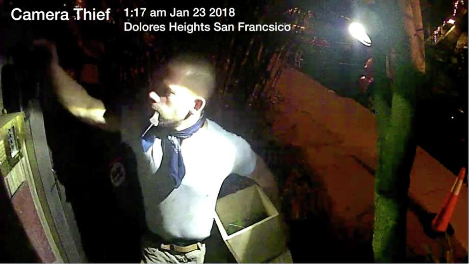 A man was caught on video ripping a security camera from a house near Dolores Park. Photo: YouTube Screen Capture / LotsOfRobots