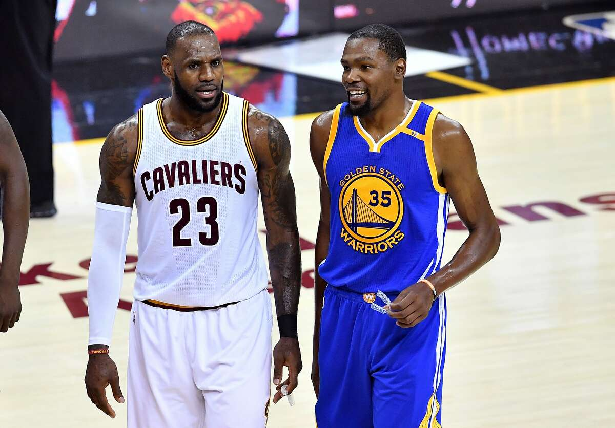 CLEVELAND, OH - JUNE 09: LeBron James #23 of the Cleveland Cavaliers and Kevin Durant #35 of the Golden State Warriors speak after a foul in the third quarter in Game 4 of the 2017 NBA Finals at Quicken Loans Arena on June 9, 2017 in Cleveland, Ohio. NOTE TO USER: User expressly acknowledges and agrees that, by downloading and or using this photograph, User is consenting to the terms and conditions of the Getty Images License Agreement. (Photo by Jason Miller/Getty Images)