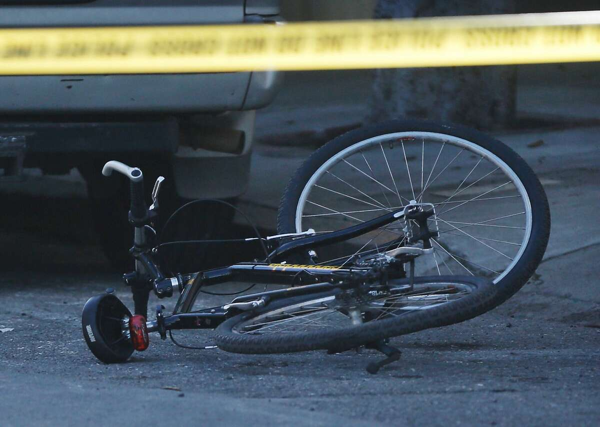 An SFPD bicycle lies mangled in the street as officers investigate the scene where an SFPD officer on a bicycle was hit near Pierce and Hayes streets in San Francisco, Calif. Thursday, Feb. 1, 2018.