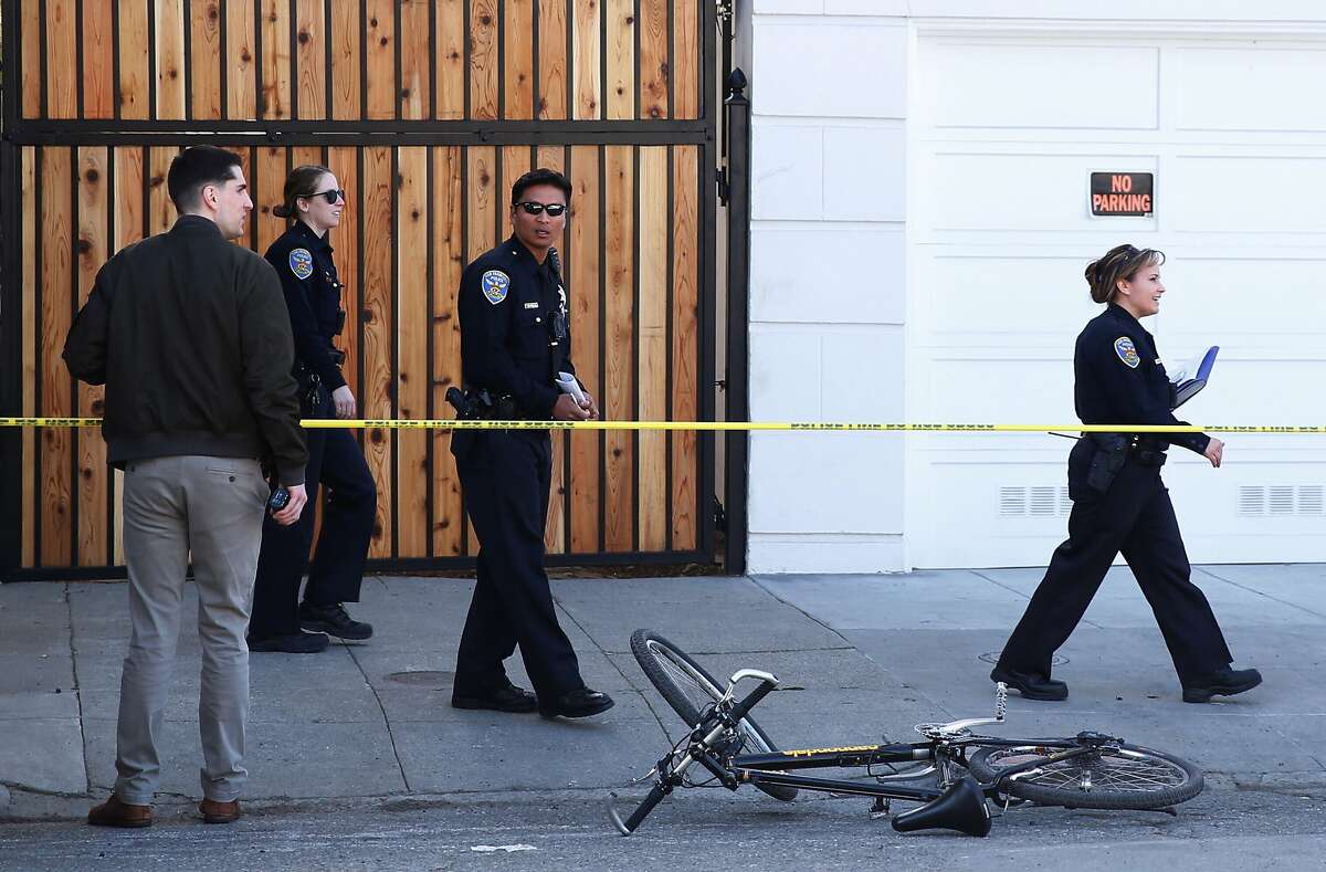 Officers investigate the scene where an SFPD officer on a bicycle was hit near Pierce and Hayes streets in San Francisco, Calif. Thursday, Feb. 1, 2018.