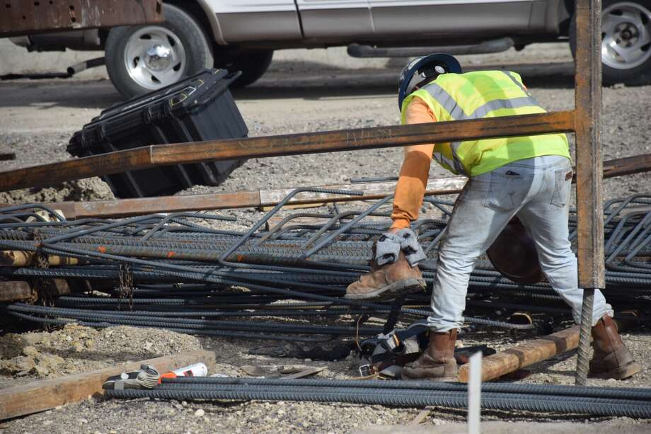 Three construction workers were crushed by around 1,000 pounds of rebar Thursday afternoon in a construction site accident at Loop 410 and U.S. 90. Photo: Caleb Downs / San Antonio Express-News