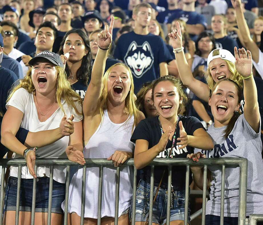 UConn fans cheer during a game at Rentschler Field in East Hartford. Photo: Catherine Avalone / Hearst Connecticut Media File Photo / Catherine Avalone/New Haven Register