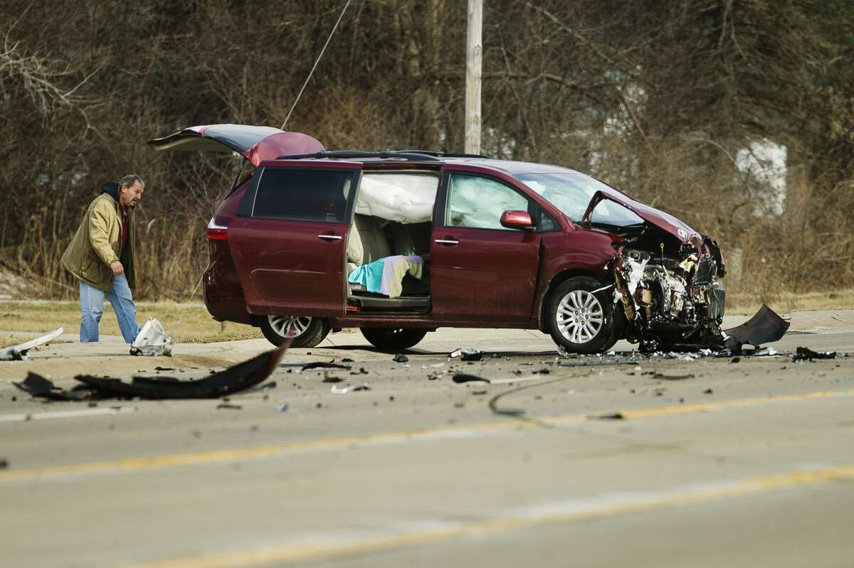 Debris is scattered across M-20 after a collision between two vehicles near Westlawn Drive on Thursday, Feb. 1, 2018. (Katy Kildee/kkildee@mdn.net)