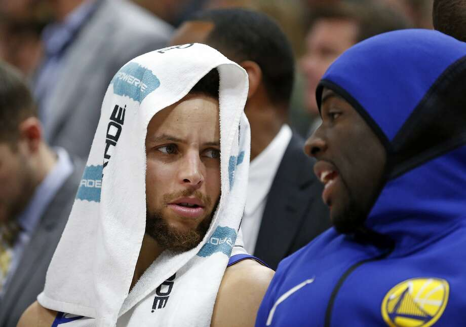 Golden State Warriors' Stephen Curry, left, and Draymond Green, right, talk on the bench in the second half during an NBA basketball game against the Utah Jazz Tuesday, Jan. 30, 2018, in Salt Lake City. (AP Photo/Rick Bowmer) Photo: Rick Bowmer, Associated Press